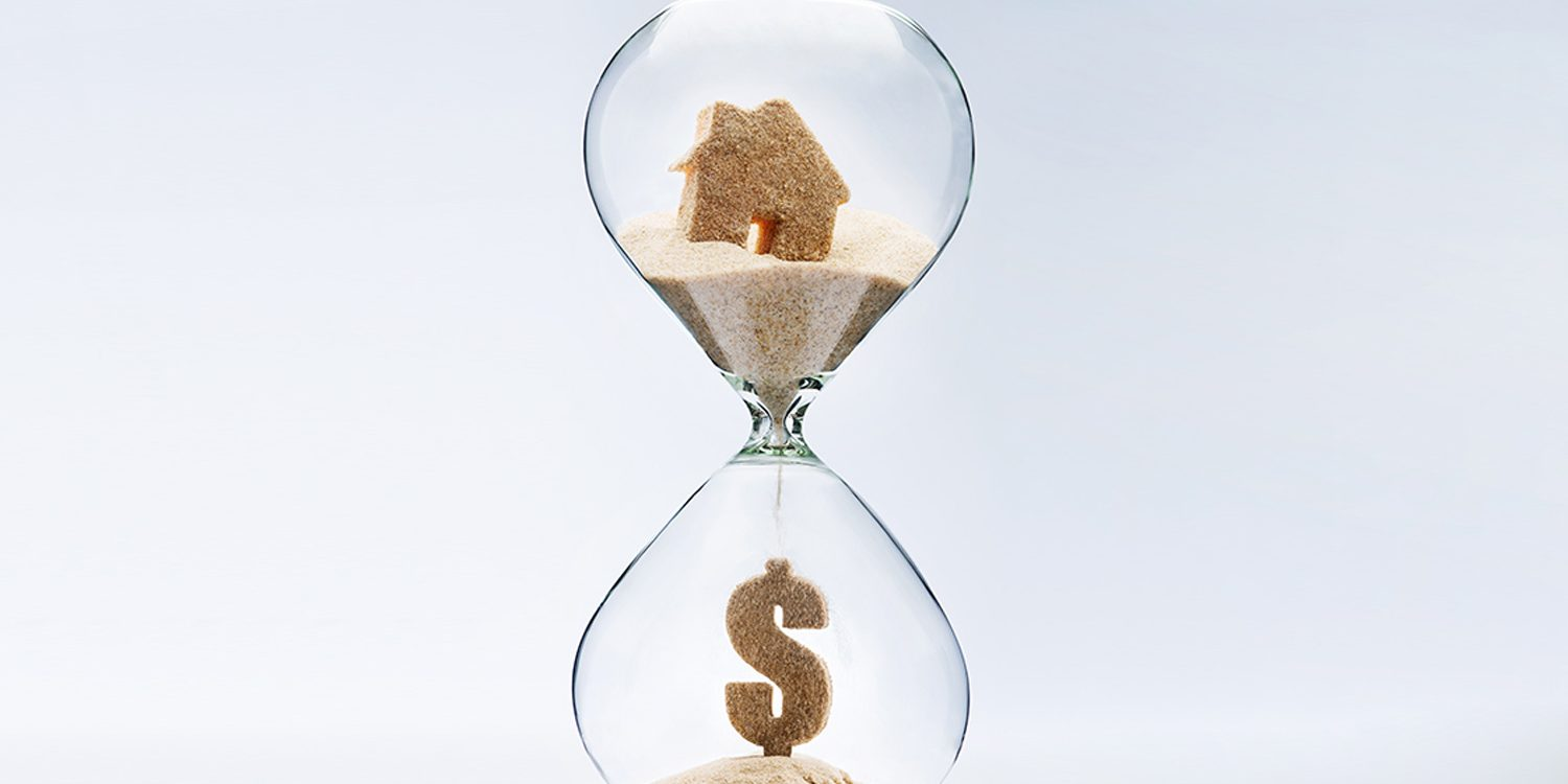 Hourglass representing time to sell house for cash