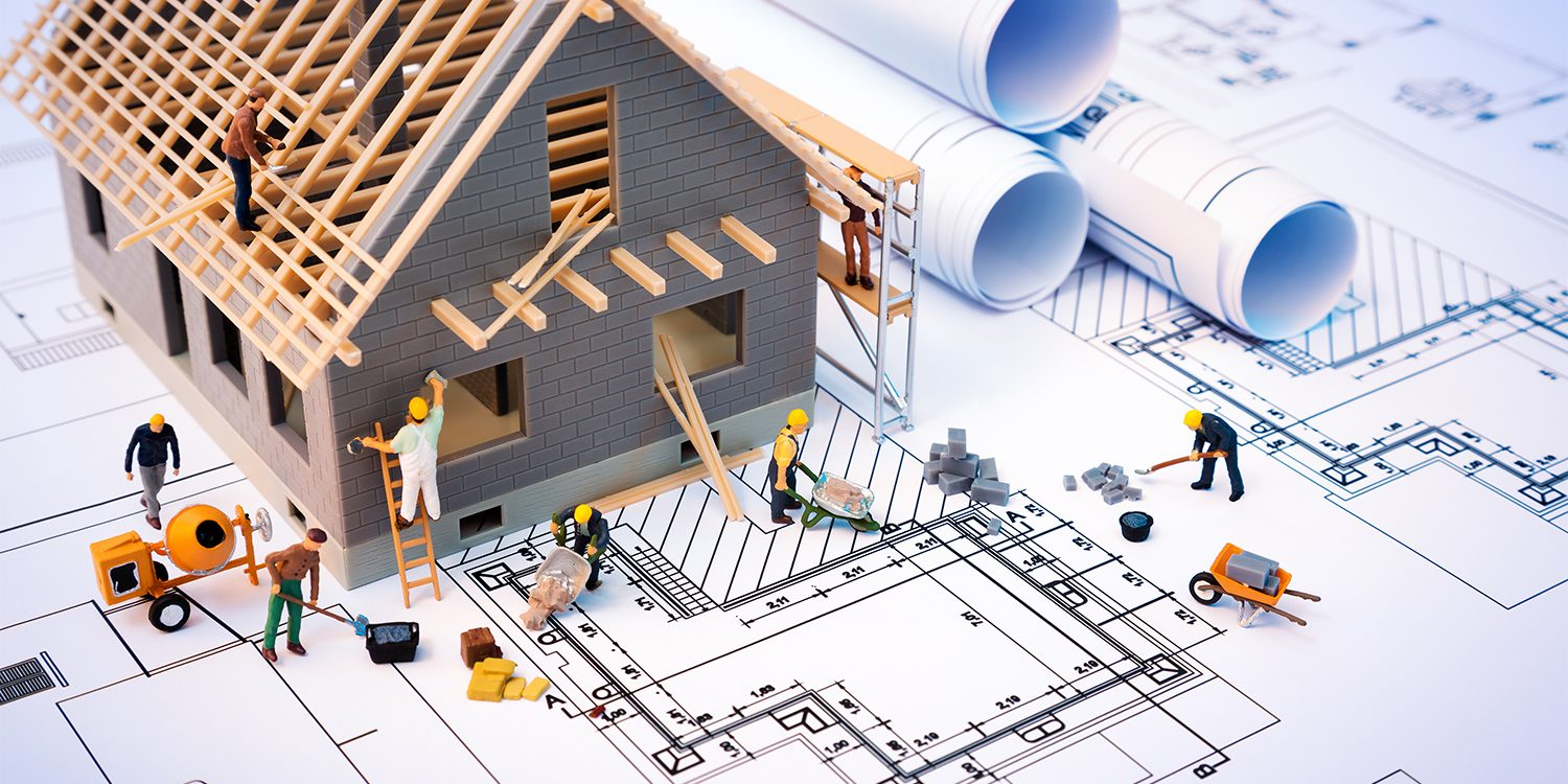 Toy houses and builders to represent house flipping concept