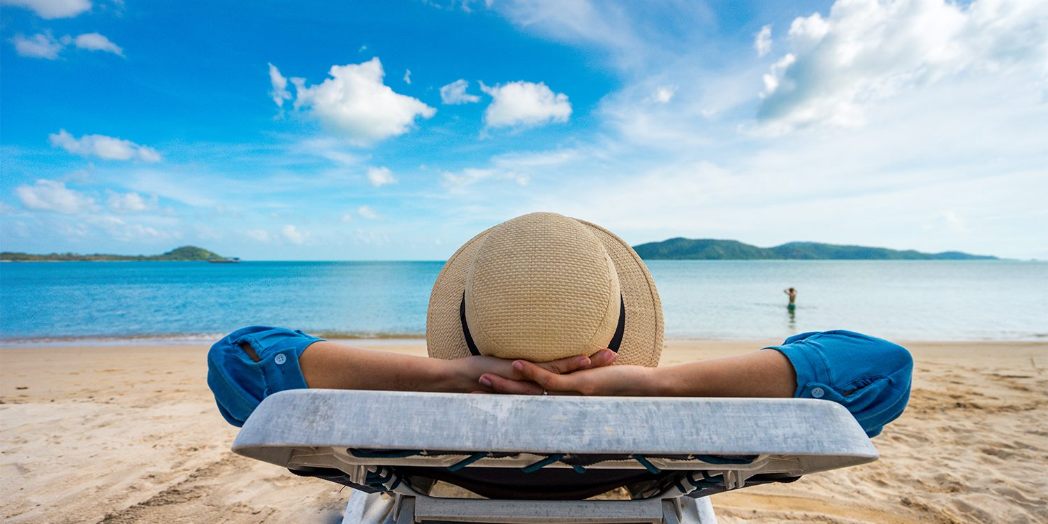 Retiree on the beach - Retirement Planning Concept